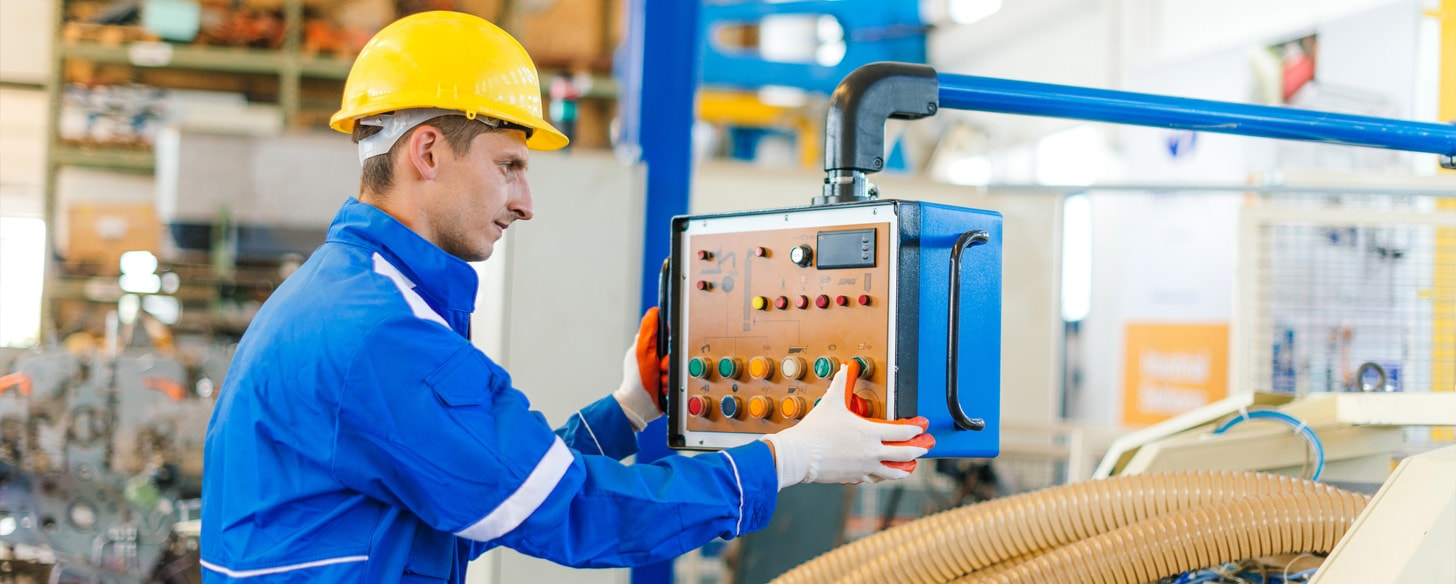 Man working on assembly line controller